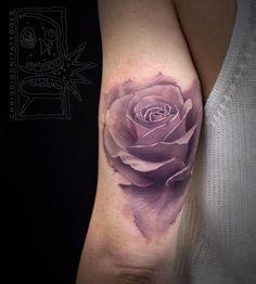 Elegant pink rose tattoo by Chris Rigoni