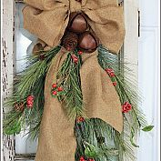 Easy burlap bow, rusty bells and a swag of pine!