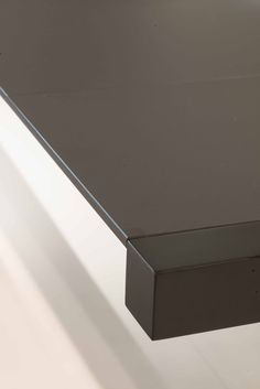Table top in FENIX NTM - a new Italian laminate surface with low reflectivity/matte surface.  Scratches can be healed with applying heat from an iron!
