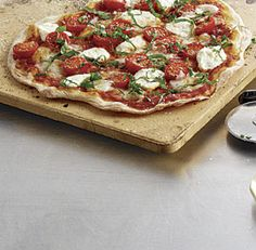 Cracker-Thin Pizza with Cherry Tomatoes, Fresh Mozzarella, Ricotta, and Basil
