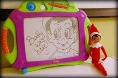 Elf leaves a note on the doodle pad