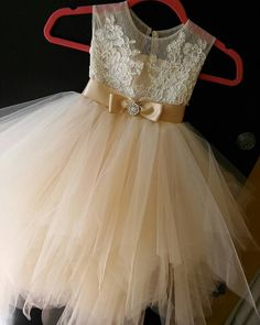 Flower girl dress with butterscotch champagne tulle skirt and satin sash.The bodice is made of tan/ nude see through English net and ivory french lace . Tea length puffy skirt of butterscotch champagne tulle. Delicate pearl buttons closure and sheer back give an elegant finish to this stunner. Its glamorous,fun, light and airy, perfect for spring/summer wedding or any special occasion.  Please take note our current turn around time is 8 weeks plus shipping time which usually takes additional…