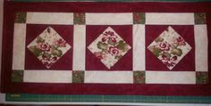 Diamond in a square table runner. Easy and quick to make. Made it for my daughter.