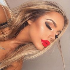 Stunning makeup look. Beautiful contour and glossy red lip.