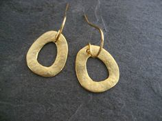 These earrings are hand carved out of wax and cast in .925 sterling silver followed be a hand texturing and 14k gold plating. Small imperfections are left intentionally to give them an organic look.  They measure 16mm in length and 14mm in width, measured without without the earwire. The ear wires are 14k gold filled.  ================================================================== MADE TO ORDER, PLEASE ALLOW UP TO 7 BUSINESS DAYS FOR THIS ITEM TO SHIP…