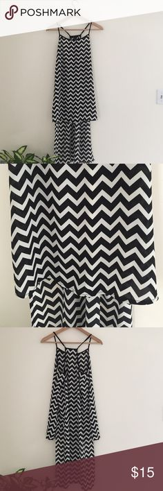 Forever 21 Black and White High Low Tunic Top Top has been worn once and is like brand new. Adjustable spaghetti straps. Flowy and pretty. Longer on the back. Perfect with leather pants or leggings. 🔥🔥🔥 Forever 21 Tops Tunics