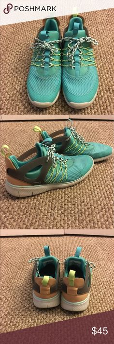 Nike running shoe Gently used Nike color is more of a teal and yellow shoes just need a little cleaning and they'll be as good as new Nike Shoes Sneakers
