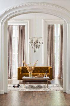 white walls + velvet sofa + symmetry