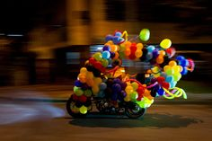 """In recent years Halloween's popularity has been on the rise worldwide. A man dressed as a clown rides his motorcycle as part of """"Moto-Halloween Party in Colombia's third largest city, Cali. Check out the Picture This archive here. Spiegel Online, Color Stories, Belle Photo, Birthday Candles, Halloween Party, Men Dress, Cool Pictures, 2013, Cali Colombia"""
