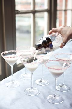 White Chocolate Peppermint Martini    2 oz Godiva White Chocolate Liqueur  1 oz Peppermint Schnapps  1 oz Vanilla Vodka  1oz Whipping cream    Combine ingredients in a martini shaker filled with ice. Shake and pour. Rim with crushed candy canes.