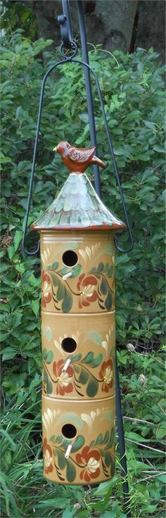 "24.25"" Tall Redware Birdhouse with Floral Design. Could use folgers coffee cans glued together with a large funnel for the roof"