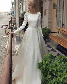 Royal-inspired mikado princess wedding dress in bateau neckline, featuring leg-of-mutton long sleeves and sensual open back with floral embroidery appliqués. Muslimah Wedding Dress, Muslim Wedding Dresses, Princess Wedding Dresses, Elegant Wedding Dress, Dream Wedding Dresses, Bridal Dresses, Dress Muslimah, Floral Wedding, Rustic Wedding