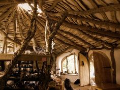 The interior view of Simon Dale's straw bale home showing the beautiful reciprocal roof structure. http://www.simondale.net/house/frame.htm