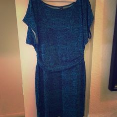 Ann Taylor turquoise dress Never worn but no tags.  This dress is classy and sassy with a synched waist flattering every shape. Ann Taylor Dresses