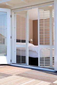 Plantation shutters for sliding door accordion for Should plantation shutters match trim