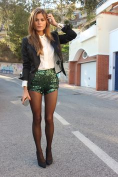 black blazer over white collar button up blouse shirt with green sequin shorts and tights - so stunning