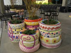 Recycling?  Pretty tires and plants.  Spring/Summer gardens