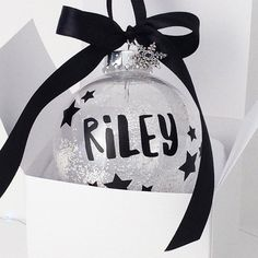 These show-stopping Personalised Baubles have been created in our signature handlettered monochrome style and are delivered in a gorgeous ribbon tied gift box.