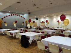Cream,burgundy and gold table decorations and arch