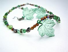 Green lucite leaf and glass beaded necklace and earring set - green beaded necklace - lucite bead necklace - woodland - light weight. $35.00, via Etsy.