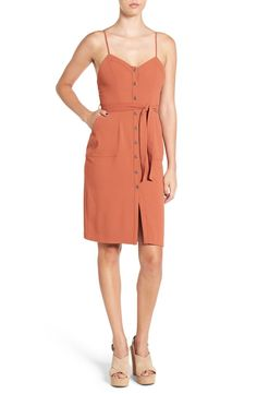 A flattering sweetheart neckline and gleaming front buttons add throwback glamour to this figure-skimming sheath dress styled with shoulder-flaunting spaghetti straps and a waist-cinching tie belt.