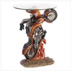 39588 Motorcycle Accent Table  Rev up your home's style in a big way by adding this authentic road hog accent table to your favorite room. $115 obo
