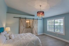 Traditional Master Bedroom with 24 in. x 80 in. 2-Panel Barn Solid Core Unfinished Knotty Alder Interior Door Slab, Barn door