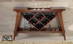 O Aparador Bar Penha possui um desenho diferenciado, dando um charme ao seu ambiente e deixando os vinhos organizados. Seu garrafeiro pode ser feito em laca (opção, azul antique, amarelo, branco ou preto). Possui também detalhe em espelho na parte superior. Medidas: 1,30 x 0,90 x 0,36 m. http://www.moradamoveis.com/