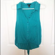 Collared Turquoise Tank This tank is a nice vibrant turquoise color. It has a collar and a tie at the bottom. It's only been worn a couple times and is in great condition!It's a size medium originally from forever21 but now fits like a small. Tops Button Down Shirts