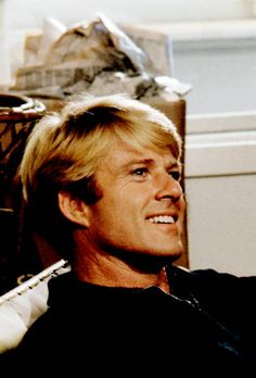 Close-up of American actor Robert Redford as he sits on a sofa in his home, New York, New York, 1968.