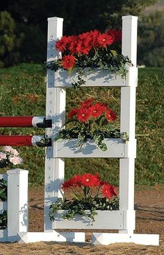 The Flower Shelf standards are a unique design allowing a full display of color and texture using silk or real flowers. http://www.premierequestrian.com/
