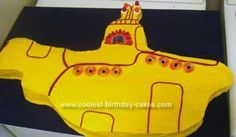 Homemade Yellow Submarine Cake: My 3 year old loves the Beatles and the yellow submarine. So I made this cake out of large cake pan bought at Michaels and used candies to decorate. It
