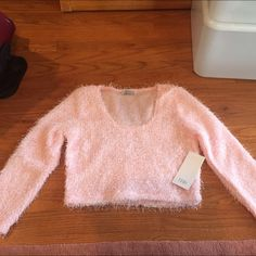 Light pink cropped fuzzy sweater!  Super cute, light pink cropped fuzzy sweater. Perfect with high waisted anything! This item is brand new with tags and has never been worn! Tobi Tops Crop Tops
