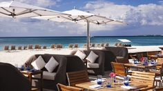 The Ritz-Carlton, Grand Cayman - Take in views of Seven Mile Beach at Bar Jack beach-front dining