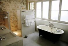 Freestanding bath, half high wall for the shower.