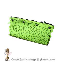 FLORESCENT GREEN - This trend setting, day to evening, women's clutch purse shouts fashionista with its unique, laser cut floral design, dark silver hardware, and an alternate chain shoulder strap option. Special feature wristlet bangle. $24.99 on Amazon.com. #purses #clutches #lasercut