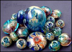 Some of my handmade glass beads, bottles, and cabochons. www.beadworx.com