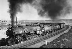 """Union Pacific 4-12-2 9514, Class UP-5, was built by ALCO in 1930, one of eighty-eight locomotives. As built, she was numbered 9077, later re-numbered to 9514. These three-cylinder locomotives had the third cylinder located in the center of the steam chest. The third cylinder drove an eccentric in the axle of the second pair of drivers. The UP 9000s had two outside 27""""x32"""" cylinders driving the third set of drive wheels and a third 27""""x31"""" cylinder in the center driving the second axle."""