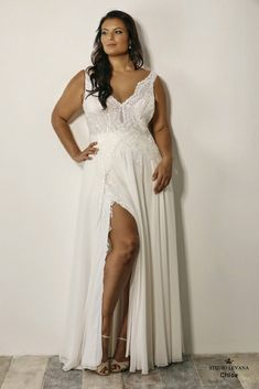 Sophisticated look of this plus size wedding gown with beaded bodice and sexy slit will make your look unforgettable. Chloe. Studio Levana