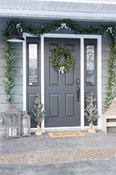 Cozy Farmhouse Christmas Porch Nothing is more nostalgic this time of year than a farmhouse porch all decked out for the holidays! With a few touches of traditional greenery and just a hint of plaid, this cozy farmhouse Christmas porch was so simple to de Front Door Porch, Grey Front Doors, Painted Front Doors, Front Door Decor, Gray Front Door Colors, Porch Doors, House Doors, Facade House, Colored Front Doors
