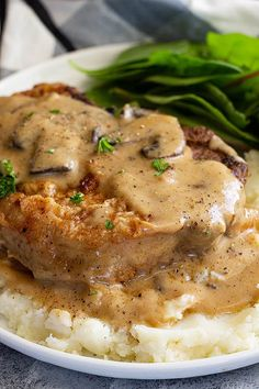 Juicy pan fried pork chops smothered in a creamy mushroom sauce. All made in one pan and in 30 minutes. Pan Fried Pork Chops, Pork Chops And Gravy, Mushroom Pork Chops, Mushroom Gravy, Baked Pork, Grilled Pork, Mushroom Sauce, Stuffed Pork Chops, Easy Pork Chop Recipes