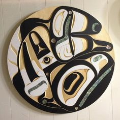 Killerwhale panel. 36 inch. Yellow cedar and abalone. Native art by Moy Sutherland. Www.moysutherland.com