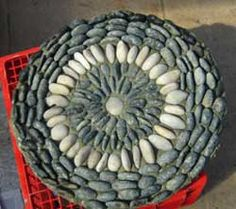 How to make your own Pebble Mosaic Stepping Stones.