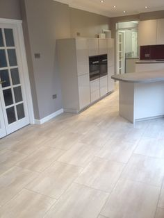 Karndean Opus flooring installed by us - the large tiles work in this stunning Kitchen.