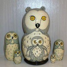 GREY OWL WITH OWLETS