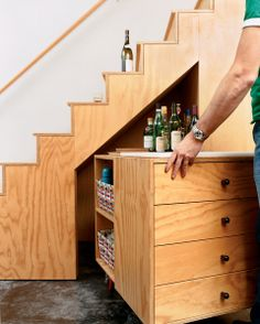 Bar cabinet tucked away under the stairs