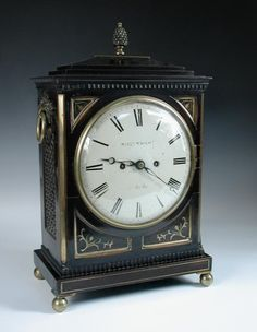 Sale F261114 Lot 600  William Wright of Cambridge, a Regency stained wood and brass inlaid bracket clock, the typical rectangular case with brass finial above 8inch (20cm) painted signed dial, the shaped top backplate also signed and with engraved border, the twin fusee movement lacking holdfast screw, adjustable pendulum, pull repeat cord, raised on four ball feet, 47cm high.  - Cheffins