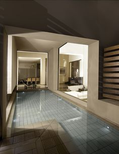Too closed in for me, but i like the idea of having the pool off of the finished basement and having glass partitions.