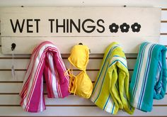 Items similar to Beach Pool Towel Bathing Suit Holder Rack Hooks from Salvaged repurposed up-cycled Wooden Shutters Reads Wet Things on Etsy - Osiris. Wooden Shutters, Primitive Shutters, Pool Towels, Swimming Towels, Hot Tub Deck, House Essentials, Pool Signs, Beach Pool, Pool Fun