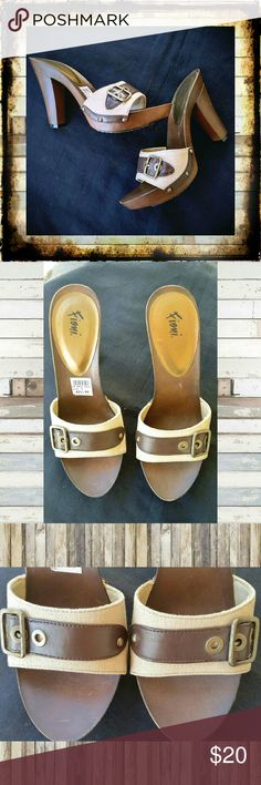 Fioni Cream & Brown Buckle Sandals New with tags, cute faux wood Fioni sandals size 9. Woven textile material with brown buckle strap. Bronze river detailing. Never worn.   #Fioni #brownsandals #mules #woodsandals #woodensandals Fioni Shoes Sandals